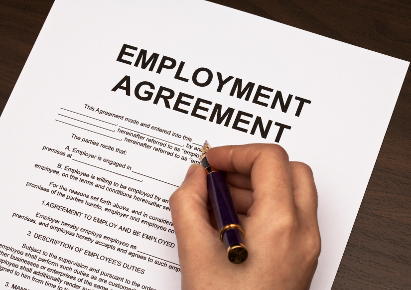filling out employment agreement